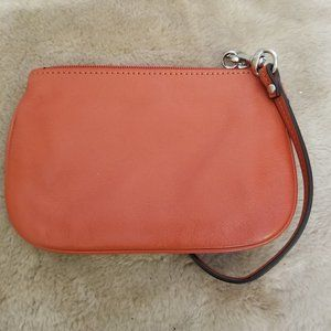 Coach leather wristlet in burnt orange